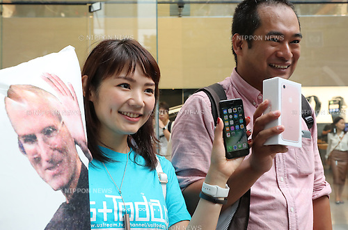 September 16, 2016, Tokyo, Japan ? Customers show the newly purchased Apple's iPhone 7 at an Apple store in Tokyo on Friday, September 16, 2016. Apple launched the new iPhone 7 and 7 Plus on Japanese market.   (Photo by Yoshio Tsunoda/AFLO) LWX -ytd-