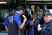 May 3, 2013; Commerce, GA, USA: Crew members for NHRA top fuel dragster driver Pat Dakin eat ice cream cones during a rain delay to qualifying for the Southern Nationals at Atlanta Dragway. Mandatory Credit: Mark J. Rebilas-