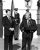 "German Chancellor Helmut Schmidt (at podium) speaks at the joint communique shortly before departing from the White House in Washington, DC as United States President Ronald Reagan looks on from the left following a long meeting on January 5, 1982.  Schmidt expressed alarm at the high interest rates in the US but it is expected he will back the President on Poland and be critical of the Soviet Union and their intervention in that country. Helmut Schmidt passed away on November 10, 2015 at age 96.<br /> Credit: Benjamin E. ""Gene"" Forte / CNP<br /> Credit: Benjamin E. ""Gene"" Forte / CNP"