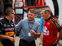 Jun 2, 2018; Joliet, IL, USA; NHRA president Glenn Cromwell (center) talks with top fuel drivers Richie Crampton (left) and Doug Kalitta during qualifying for the Route 66 Nationals at Route 66 Raceway. Mandatory Credit: Mark J. Rebilas-USA TODAY Sports