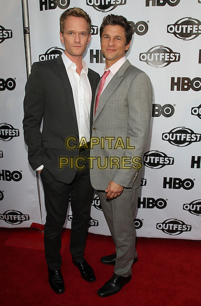 Neil Patrick Harris and David Burtka.2011 Outfest Film Festival Opening Night Gala with Screening Of 'Gun Hill Road' Held At The Orpheum Theatre, Los Angeles, California, USA..July 7th, 2011.full length black grey gray suit couple white shirt.CAP/ADM/KB.©Kevan Brooks/AdMedia/Capital Pictures.