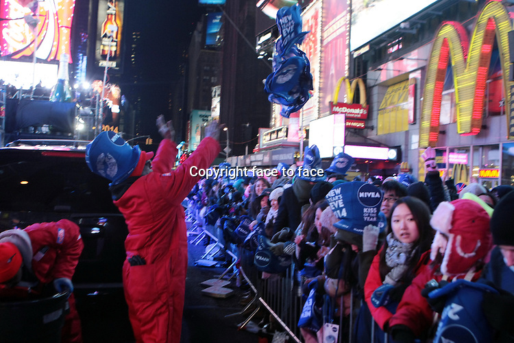 New York, NY-December 31: New Years Eve Revelers at the 2014 New Years Eve Celebration held in Times Square on December 31, 2013 in New York City.<br />