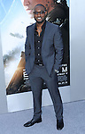 Adrian Holmes at The World Premiere of Elysium held at the Regency Village Theatre in Los Angeles, Ca. August 7, 2013.