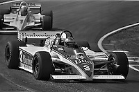LEXINGTON, OH - SEPTEMBER 11: Mario Andretti drives his Lola T700/Cosworth ahead of Rick Mears during the Escort Radar Warning 200 on September 11, 1983, at the Mid-Ohio Sports Car Course near Lexington, Ohio.
