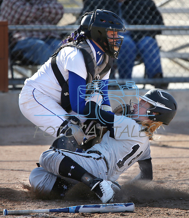 Western Nevada's Sydney Darby tags College of Southern Idaho's Tyler Wilkinson out at home during a college softball game in Carson City, Nev., on Friday, March 22, 2013..Photo by Cathleen Allison/Nevada Photo Source