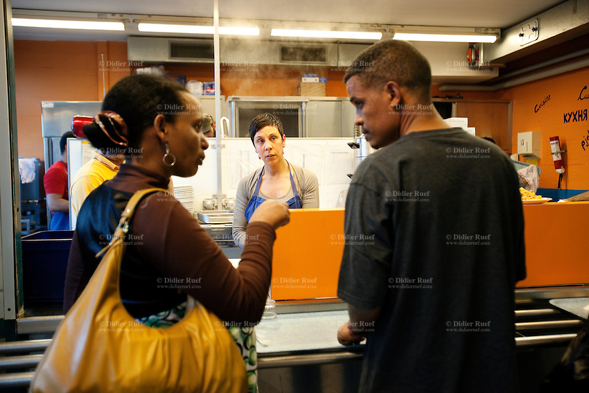 Switzerland. Canton Ticino. Chiasso. Inside a centre for immigrants under the authority of the the Federal Office for Migration, a couple of migrants from Eritrea is talking while waiting to get their food.  The man and the woman are economic migrants and have asked for political asylums in Switzerland. They are now waiting for the answers from the swiss government..08.04.11 © 2011 Didier Ruef