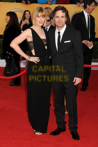 SUNRISE COIGNEY & MARK RUFFALO.17th Annual Screen Actors Guild Awards held at The Shrine Auditorium, Los Angeles, California, USA..January 30th, 2011.SAG arrivals full length black white  dress married husband wife sleeveless sheer strap .CAP/ADM/BP.©Byron Purvis/AdMedia/Capital Pictures.