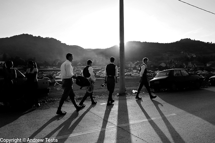 SERBIA. Guca. 10th August 2008..A band walks home after the end of the competition on the final day of the festival..©Andrew Testa/Panos Pictures