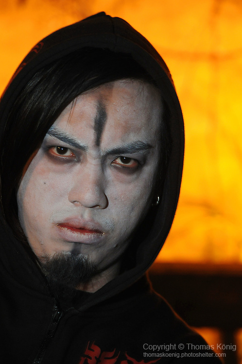 Chthonic Concert, Kaohsiung -- Close-up of Chthonic guitarist Jesse Liu, aka The Infernal, with face paint during a fan audience.