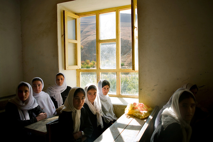 A seventh-grade class in the girls' high school in Farghamanch, Jurm district, Badakhshan province, Afghanistan, Saturday morning, Oct. 24, 2009. The head mullah, or religious leader, in Farghamanch is very powerful and it took time to acquire his support for the school to be built. The extremely religious community is also building a madrassa for religious education. As the Obama Administration seeks the formula for turning the tide of the war in Afghanistan, some aid organizations are advocating the National Solidarity Programme, a community-based development program that has made progress in some districts, setting up local councils that propose much-needed projects such as schools, drinking water facilities and roads.