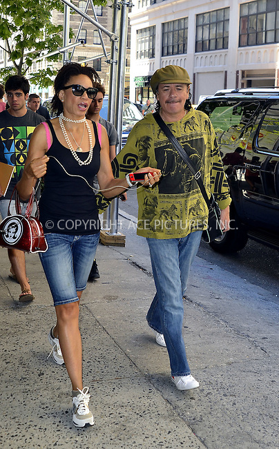 WWW.ACEPIXS.COM . . . . .  ....July 25 2012, New York City....Rock guitarist Carlos Santana and his wife musician Cindy Blackman-Santana walk in Soho on July 25 2012 in New York City....Please byline: CURTIS MEANS - ACE PICTURES.... *** ***..Ace Pictures, Inc:  ..Philip Vaughan (212) 243-8787 or (646) 769 0430..e-mail: info@acepixs.com..web: http://www.acepixs.com