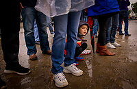 LOUISVILLE, KY - MAY 04: A young race fan looks at the horses through the legs of adults at Churchill Downs on May 04, 2017 in Louisville, Kentucky. (Photo by Alex Evers/Eclipse Sportswire/Getty Images)