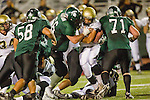 Torrance, CA 10/06/11 - unidentified Peninsula player(s), Orion Gould (South Torrance #71), Anthony Aguilar (South Torrance #58) and Kurtis Heinemann (South Torrance #66) in action during the Peninsula vs South Varsity football game.