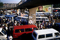 SOWETO, SOUTH AFRICA MARCH 14: Commuters queue for mini bus taxis at Baragwanath taxi station on March 14,  in Soweto, Johannesburg, South Africa. The station is the largest in the township and tens of thousands of people use it every day for travel around Johannesburg. Soweto is South Africa&rsquo;s largest township and it was founded about one hundred years to make housing available for black people south west of downtown Johannesburg. The estimated population is between 2-3 million. Many key events during the Apartheid struggle unfolded here, and the most known is the student uprisings in June 1976, where thousands of students took to the streets to protest after being forced to study the Afrikaans language at school. Soweto today is a mix of old housing and newly constructed townhouses. A new hungry black middle-class is growing steadily. Many residents work in Johannesburg, but the last years many shopping malls have been built, and people are starting to spend their money in Soweto.  <br /> (Per-Anders Pettersson)