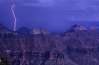 749220221 a powerful lightning bolt strikes near wotans throne and zoster temple on the north rim of grand canyon national park in arizona
