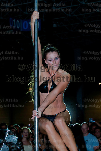 Adrienne Kelemen performs on the pole during the first ever Hungarian Pole Dance Championships organized by former striptease world champion Alma Pirner as part of the Erotic Exhibition held in Hungexpo center. in Budapest, Hungary on September 06, 2008. ATTILA VOLGYI
