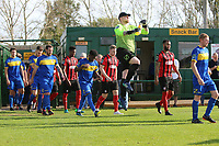 Teams enter the on to the field during Romford vs Coggeshall Town, Bostik League Division 1 North Football at Rookery Hill on 13th October 2018
