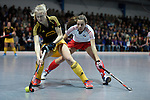 Mannheim, Germany, January 24: During the 1. Bundesliga Damen Hallensaison 2014/15 quarter-final hockey match between Mannheimer HC (white) and Harvestehuder THC (black) on January 24, 2015 at Irma-Roechling-Halle in Mannheim, Germany. Final score 2-3 (2-2). (Photo by Dirk Markgraf / www.265-images.com) *** Local caption *** Annelotte Ziehm #23 of Harvestehuder THC, Natalie Kraetsch #20 of Mannheimer HC