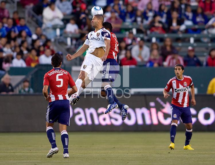 Real Salt Lake forward Alvaro Saborio (15-w) battles Chivas USA defender Dario Delgado (12-r). Real Salt Lake defeated CD Chivas USA 2-1at Home Depot Center stadium in Carson, California on Saturday May 22, 2010.  .