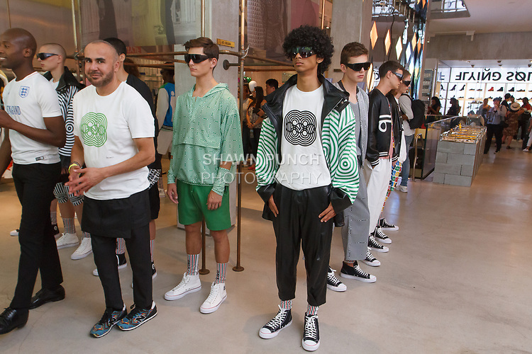 "Fashion designer Ricardo Seco (second from left) being interviewed at his Ricardo Seco Spring Summer 2019 ""Vision"" collection fashion presentation in Flying Solo, in New York City, on July 9, 2018; during New York Fashion Week: Men's Spring Summer 2019."