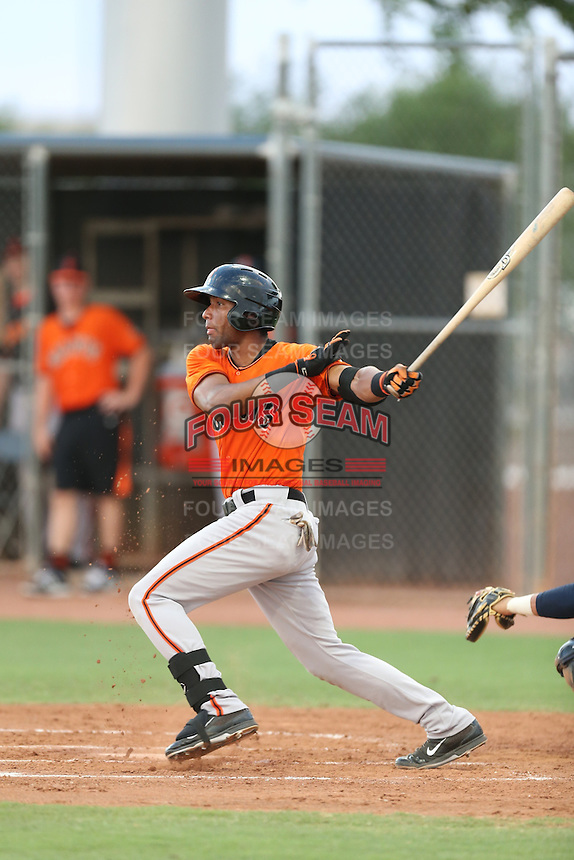 Carlos Cartagena #67 of the AZL Giants bats against the AZL Mariners at the Peoria Sports Complex on July 10, 2014 in Peoria, Arizona. AZL Giants defeated the AZL Mariners, 8-4. (Larry Goren/Four Seam Images)