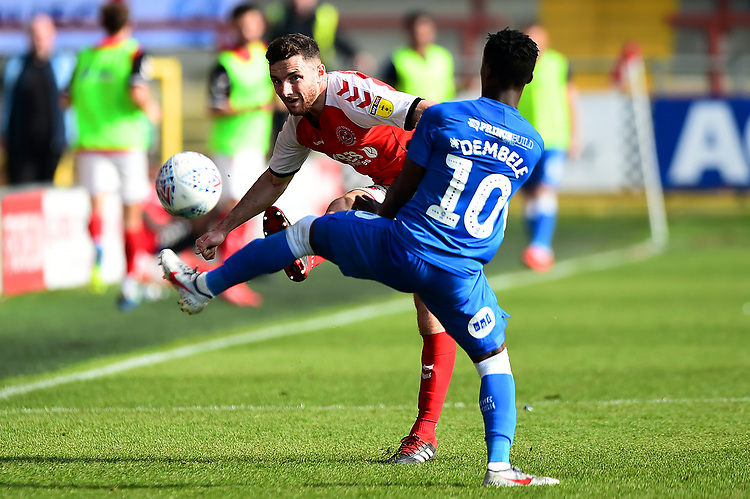 Fleetwood Town's Lewis Coyle competes with Peterborough United's Siriki Dembele<br /> <br /> Photographer Richard Martin-Roberts/CameraSport<br /> <br /> The EFL Sky Bet League One - Fleetwood Town v Peterborough United - Friday 19th April 2019 - Highbury Stadium - Fleetwood<br /> <br /> World Copyright © 2019 CameraSport. All rights reserved. 43 Linden Ave. Countesthorpe. Leicester. England. LE8 5PG - Tel: +44 (0) 116 277 4147 - admin@camerasport.com - www.camerasport.com