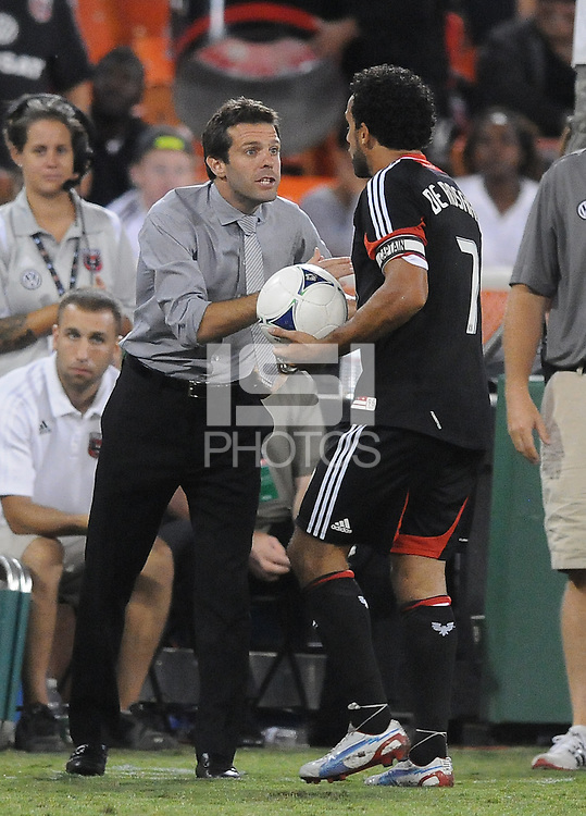 D.C. United forward Dwayne De Rosario (7) celebrates his 100th goal with head coach Ben Olsen.  The New York Red Bulls tied D.C. United 2-2 at RFK Stadium, Wednesday August 29, 2012.