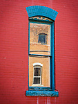 Reflections in a window, historic copper mining city of Butte, Montana