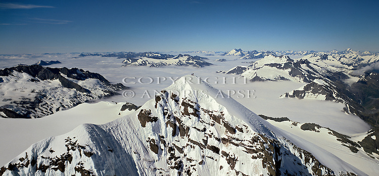 Two climbers on the summit of Mount Aspiring. Mount Aspiring National Park. Otago. New Zealand.