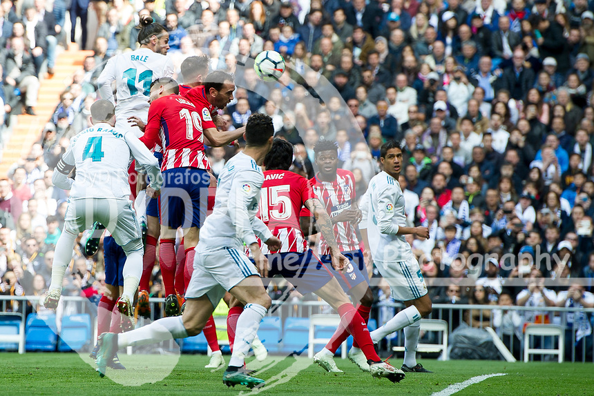 Atletico Madrid's Uruguayan defender Diego Godin; Real Madrid's Welsh forward Gareth Bale<br /> Spanish league football match Real Madrid vs Atletico de Madrid at the Santiago Bernabeu stadium in Madrid on April 8, 2018.