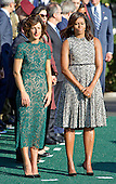 First lady Michelle Obama and Mrs. Agnese Landini of Italy listen to remarks during the Official Arrival Ceremony on the South Lawn of the the White House in Washington, DC on Tuesday, October 18, 2016. <br /> Credit: Ron Sachs / CNP