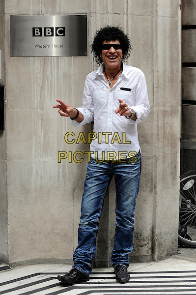 RAY DORSET aka MUNGO JERRY.Seen outside BBC Radio 2 Studios, London, England, UK, July 7th 2010..full length jeans denim white shirt hands sunglasses .CAP/IA.©Ian Allis/Capital Pictures.