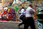 Men in business clothes walking down Hosier Lane, Melbourne Graffiti on Hosier Lane, Melbourne