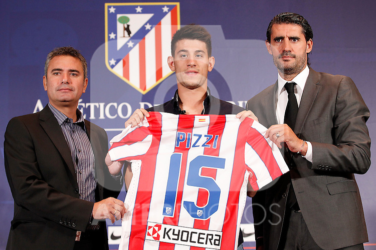 Atletico de Madrid's new player Pizzi during his official presentation with the General Manager Jose Luis Perez Caminero (r) and the ex player Manolo Sanchez (l). August 31, 2011.(ALTERPHOTOS/Acero)