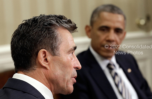 United States President Barack Obama (R) meets with NATO Secretary General Anders Fogh Rasmussen in the Oval Office of the White House May 31, 2013 in Washington, DC.  The two leaders discussed the continued reduction of troop levels in Afghanistan and other issues.  <br /> Credit: Win McNamee / Pool via CNP