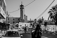 Alaa Mustafa, 24, and his cousin, Oday Muheisan, 19, ride pure breed Arabian horses, Rawnaq and Furys, through the streets of Essawiya on June 07, 2016 in East Jerusalem. <br /> Photo Daniel Berehulak for the New York Times
