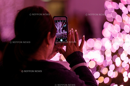 A woman takes a picture of the illuminations at Shinjuku Terrace City on November 16, 2017, Tokyo, Japan. Shinjuku Terrace City Illuminations are seen around Odakyu Line Shinjuku Station. This year marks the 12th year of the illumination event, which can be enjoyed until February 22, 2018. (Photo by Rodrigo Reyes Marin/AFLO)