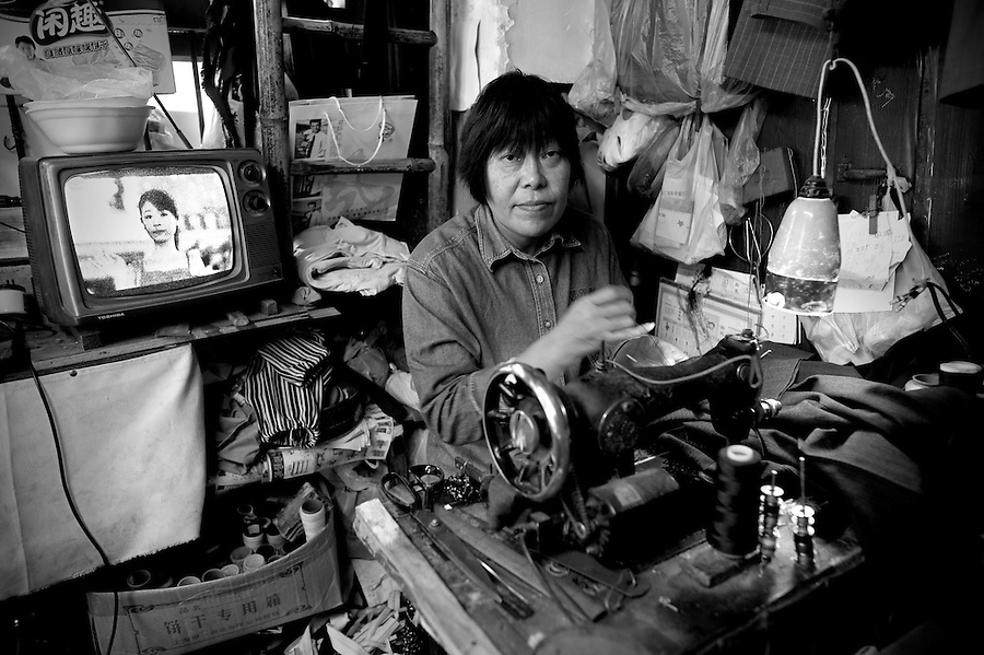 Shanghai Portraits 4 - A seamstress works in a small shop in Shanghai.