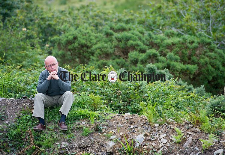 Local school principal Martin Keane at the celebration of Sunday mass at The Mass Rock in Clonigulane, Kilmihil, the first since the 1730's. Photograph by John Kelly.