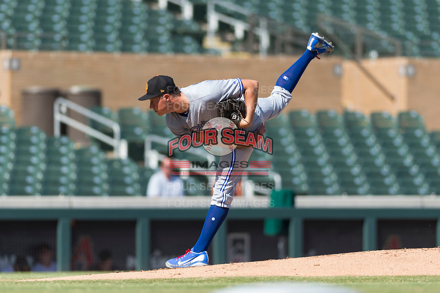 Surprise Saguaros starting pitcher Nate Pearson (20), of the Toronto Blue Jays organization, follows through on his delivery during an Arizona Fall League game against the Salt River Rafters at Salt River Fields at Talking Stick on October 23, 2018 in Scottsdale, Arizona. Salt River defeated Surprise 7-5 . (Zachary Lucy/Four Seam Images)