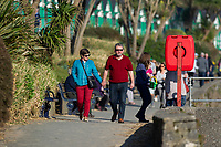 WEATHER PICTURE WALES<br /> A couple take a stroll during the unusually warm weather in Langland Bay near Swansea, Wales, UK. Wednesday 27 February 2019