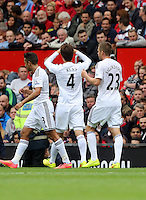 Pictured: Ki Sung Yueng celebrating his goal with team mates. Saturday 16 August 2014<br /> Re: Premier League Manchester United v Swansea City FC at the Old Trafford, Manchester, UK.