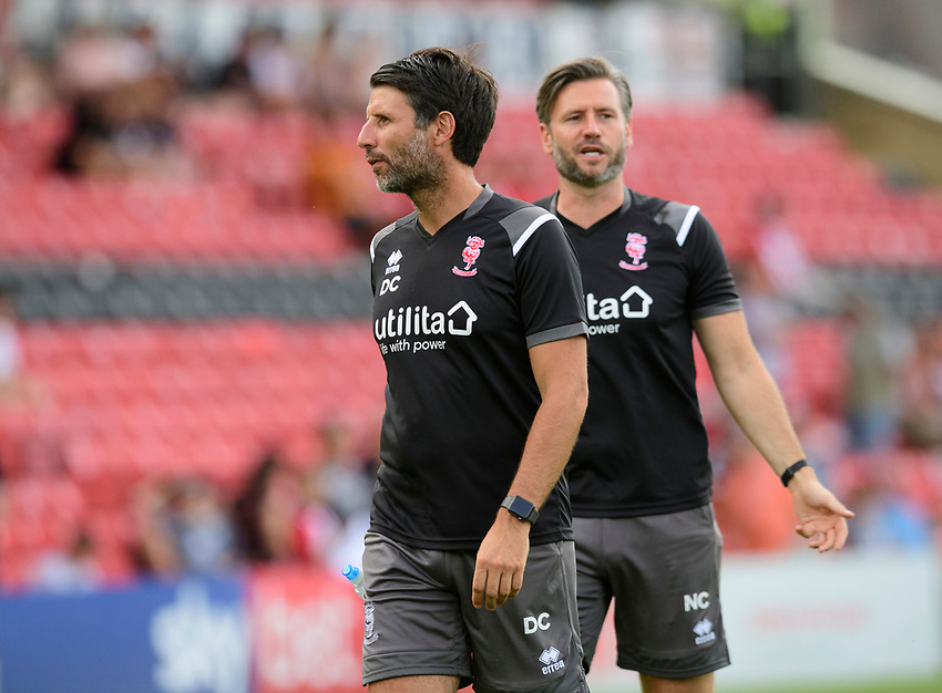 Lincoln City manager Danny Cowley, left, and Lincoln City's assistant manager Nicky Cowley during the pre-match warm-up<br /> <br /> Photographer Chris Vaughan/CameraSport<br /> <br /> Football Pre-Season Friendly - Lincoln City v Stoke City - Wednesday July 24th 2019 - Sincil Bank - Lincoln<br /> <br /> World Copyright © 2019 CameraSport. All rights reserved. 43 Linden Ave. Countesthorpe. Leicester. England. LE8 5PG - Tel: +44 (0) 116 277 4147 - admin@camerasport.com - www.camerasport.com