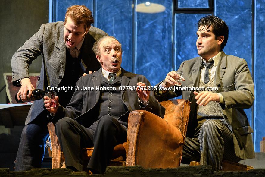 "London, UK. 24.11.2018. English National Opera present their fourth revival of Jonathan Miller's production of Puccini's ""La Boheme"", in which Natalya Romaniw makes her ENO debut. Cast is: Natalya Romaniw (Mimi), Jonathan Tetelman (Rodolfo), Nicholas Lester (Marcello), Simon Butteriss (Benoit/Alcindoro), Nadine Benjamin (Musetta), David Soar (Colline), Bozidar Smiljanic (Schaunard). Picture shows: Bozidar Smiljanic (Schaunard), Simon Butteris (Benoit), Jonathan Tetelman (Rodoflo). Photograph © Jane Hobson."