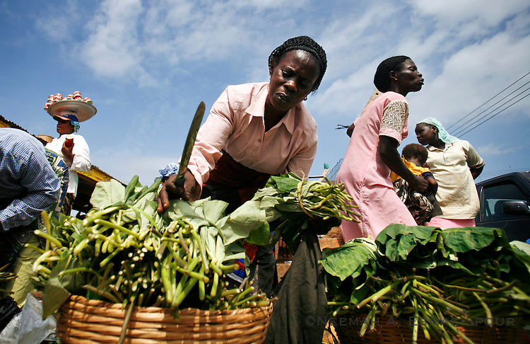 Women prepare to sell vegetables at a market in Accra, Ghana.