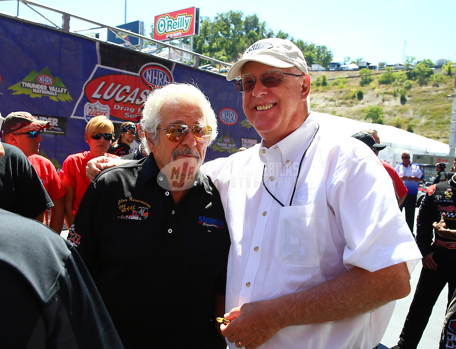 Jun 19, 2016; Bristol, TN, USA; NHRA top fuel driver Chris Karamesines (left) with NHRA official Graham Light during the Thunder Valley Nationals at Bristol Dragway. Mandatory Credit: Mark J. Rebilas-USA TODAY Sports
