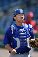Dunedin Blue Jays catcher Derrick Chung (1) watches a ball go out of play during a game against the Clearwater Threshers on April 6, 2014 at Bright House Field in Clearwater, Florida.  Dunedin defeated Clearwater 5-2.  (Mike Janes/Four Seam Images)