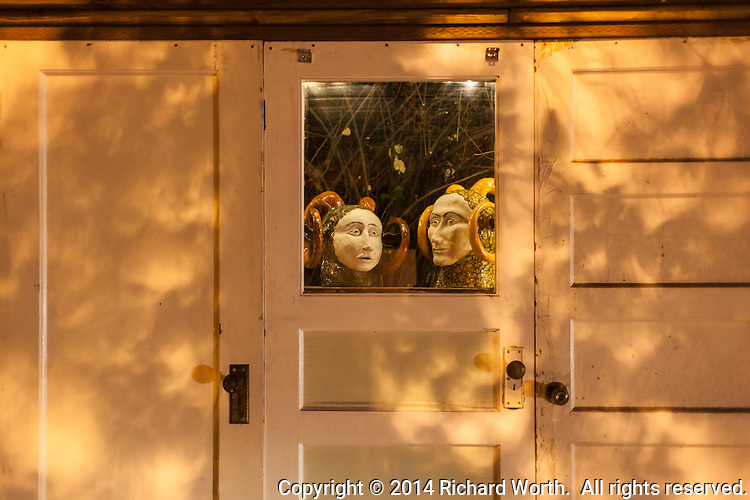 Artwork looks out from an unusual display along a Berkeley, California, street.