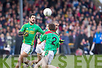 Paul Galvin of Finuge contests the loose ball with Philip Blake and Paul Collins of Beal in the Bernard O'Callaghan Memorial Senior Football Championship Final last Sunday in Ballylongford.