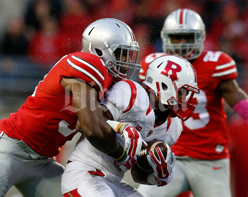 Ohio State Buckeyes linebacker Joshua Perry (37) tackles Rutgers Scarlet Knights running back Desmon Peoples (6) during the third quarter of the NCAA football game at Ohio Stadium in Columbus on Oct. 18, 2014. (Adam Cairns / The Columbus Dispatch)